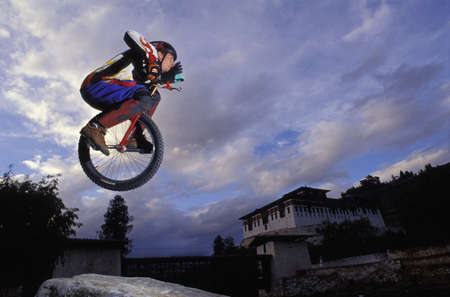 Unicyclist taking a jump photo