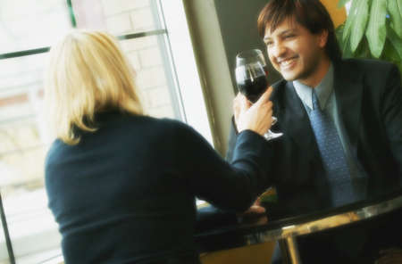 Young professional couple drinking wine Stock Photo - 6214320
