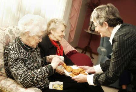 Elderly women having cookies