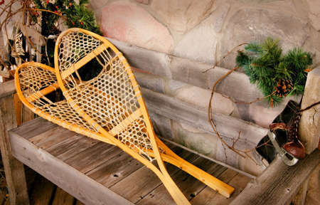 Snowshoes and old ice skates photo