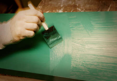 staining: Painting a piece of wood Stock Photo