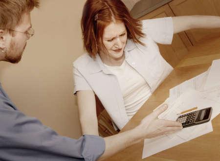 Couple fighting over bills photo