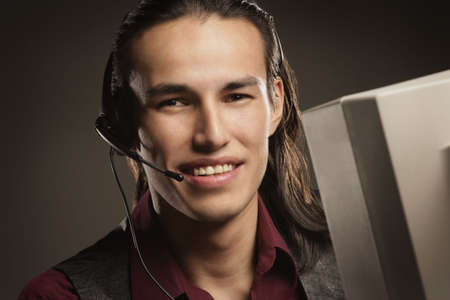 clerical: Aboriginal call centre worker Stock Photo