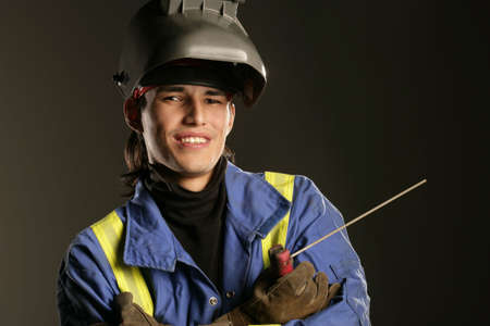 knowledgeable: Aboriginal man with welding equipment
