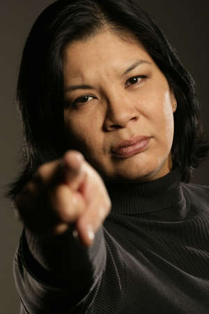 Aboriginal woman pointing photo