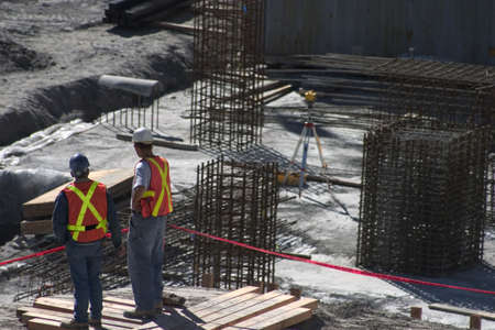 fabrication: Building site and two construction workers Stock Photo