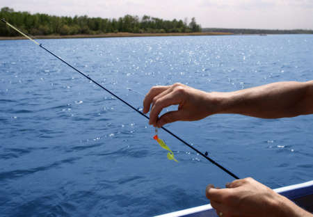 hand line fishing: Lure being put on fishing line