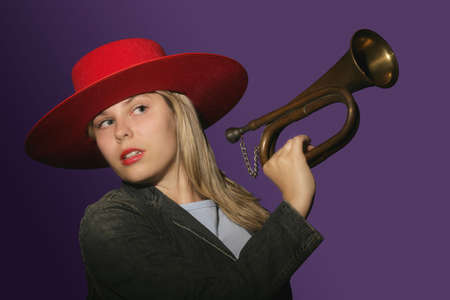 reveille: Blowing your own trumpet Stock Photo