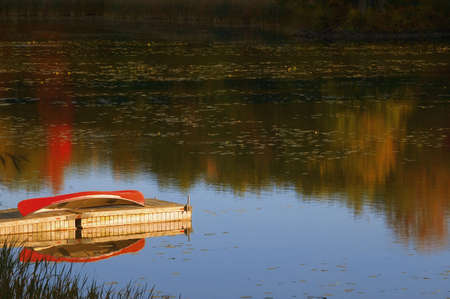 carson ganci: Canoe on dock
