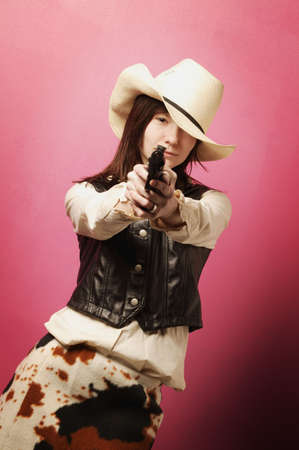 Cowgirl with gun photo