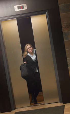 people in elevator: Late for work-getting off elevator