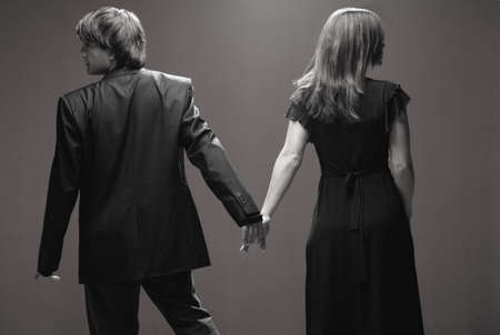 opposites: Couple looking in opposite directions