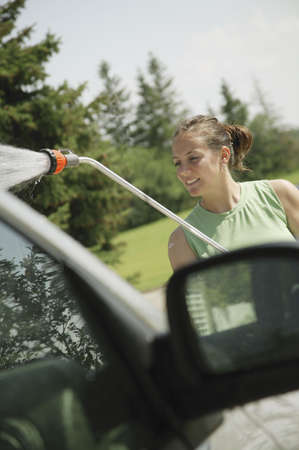 Woman washing the car photo