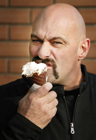 Man eating ice cream photo
