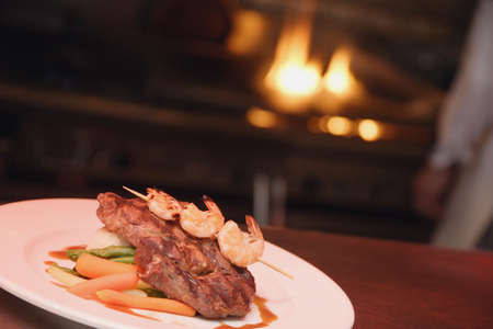Steak and shrimp meal photo