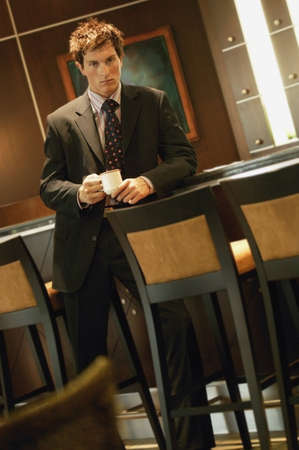 Businessman with cup of coffee photo