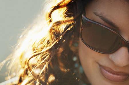 designer: Attractive woman wearing designer sunglasses Stock Photo