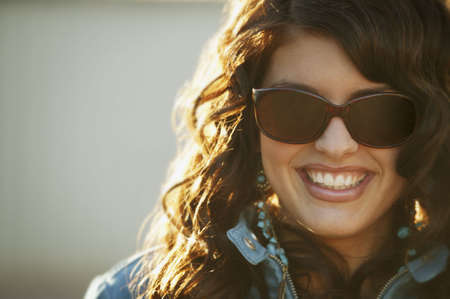 Attractive woman modeling trendy sunglasses photo