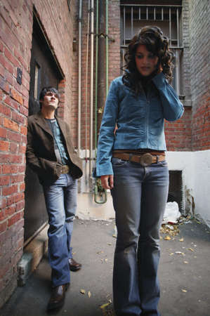 stood up: Fashionable couple in an alley Stock Photo