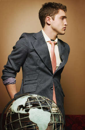 Young man with globe photo