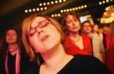 worshipping: Woman worshipping the Lord