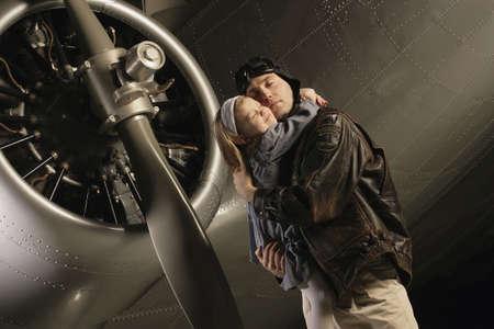 Pilot hugging child photo