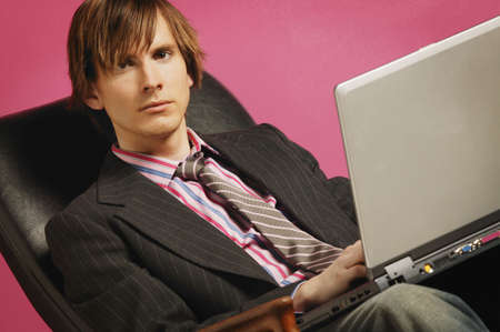 Businessman with laptop Stock Photo - 5658024