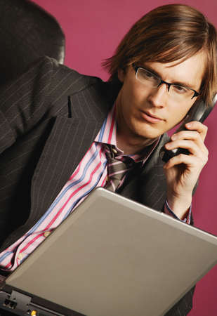 Businessman with phone and lap top photo