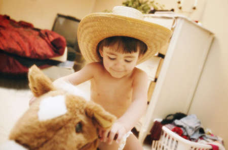 Child on pretend horse