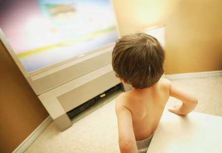 Young child watching TV Stock Photo