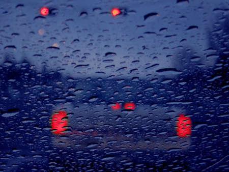 dismal: Vehicle lights in rain Stock Photo