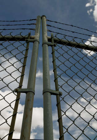 Chain link gate with barbed wire photo