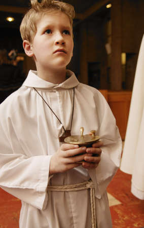 religious service: Alter boy holding container