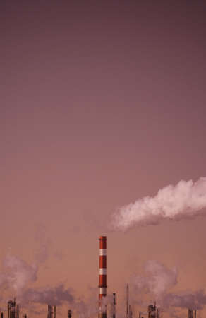 Industrial chimneys and fumes photo