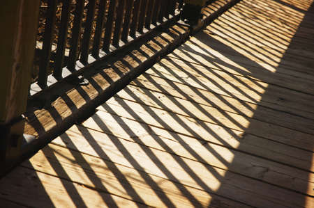 imaginor: Shadow of wooden railing
