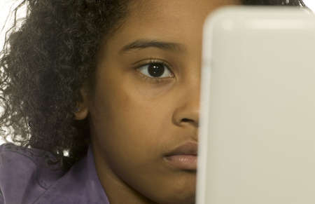 Young girl using a computer photo