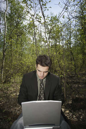 Working on a pc in a woodland glade photo