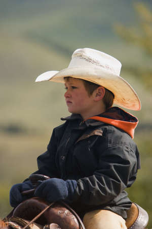 cowboy up: A young cowboy on cattle round up in Southern Alberta Canada Stock Photo