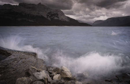 glowering: Threatening skies and rock shoreline