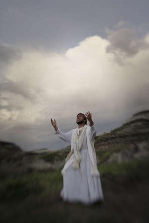 Jesus reaches up