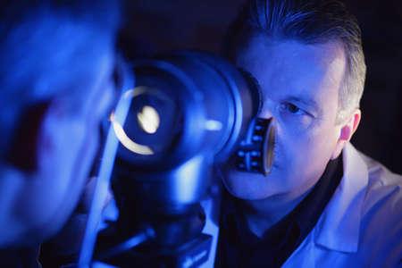 Optometrist administering an eye exam photo