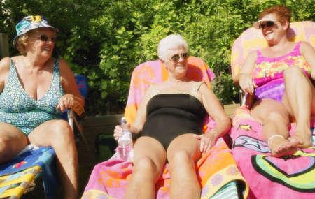Group of three women sunbathing Stock Photo