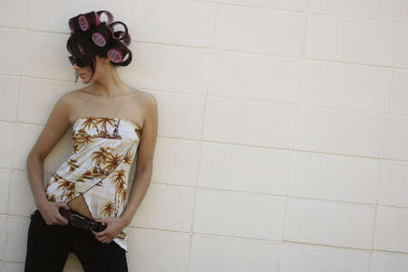 A woman with curlers in her hair photo