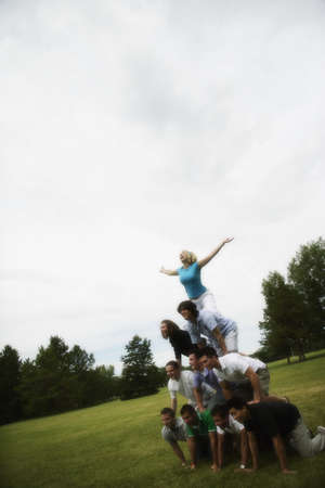 A group of young people making a pyramid Stock Photo - 6214924