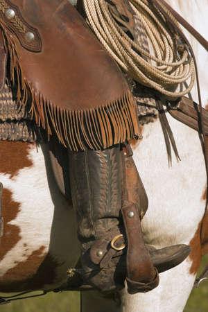A close-up of a roper on horseback photo