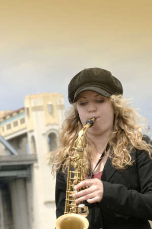 A young woman playing the saxophone