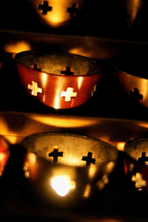 tanasiuk: Candles burning in a church