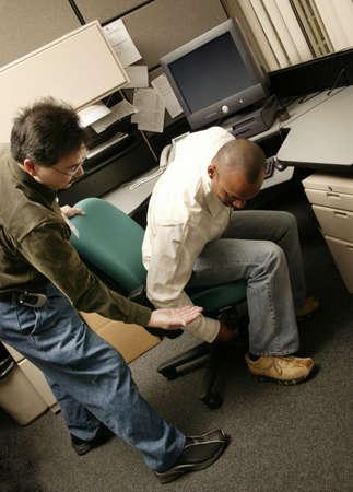 werk: Een werkt met een client beroeps therapist Stockfoto