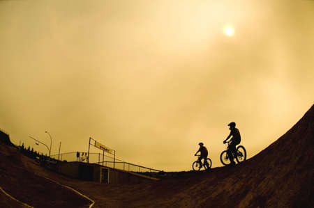 corey hochachka: Two cyclists Stock Photo