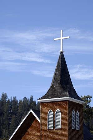 A cross on a church spire Stock Photo